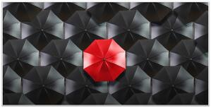 Differentiation Red Umbrella in Black Umbrellas