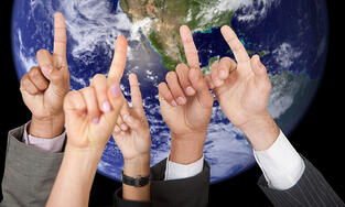 People raising their hands to participate and the earth on the background