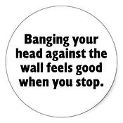 banging_your_head_against_a_brick_wall_sticker-p217367976180528591z8j38_400